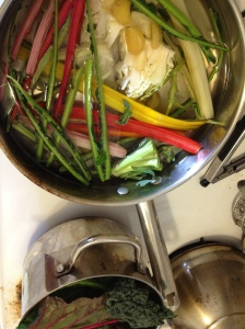 while cooking, I tossed all of my brightly colored stems and odds and ends into a vat of water, simmered for an hour or so, and PRESTO....an optimally healthy, organic veggie broth.
